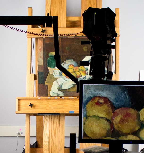 Photographing Paul Cezanne's Still Life with Commode in the digital imaging department's photography studio. Photo: Zak Jensen.