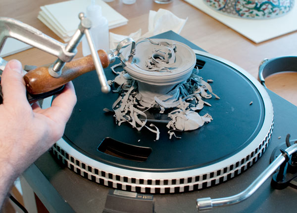 Plasticine is mounted on the turntable to rough out the neck and spout shape. Photo: Tony Sigel.