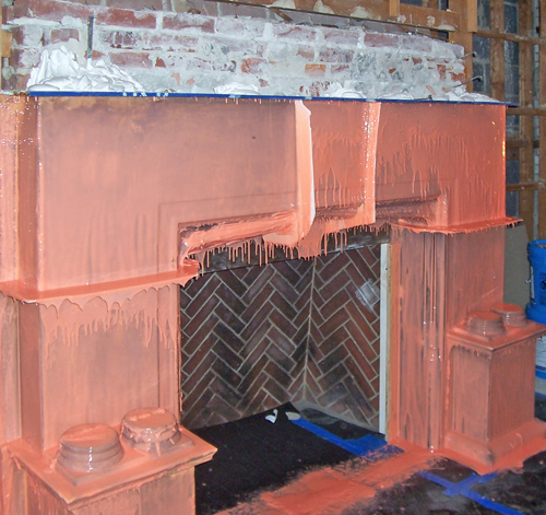 Fireplace during deinstallation, coated with a silicone rubber mold-making material, allowing for future recasting, 2008. Photo: Peter Atkinson.