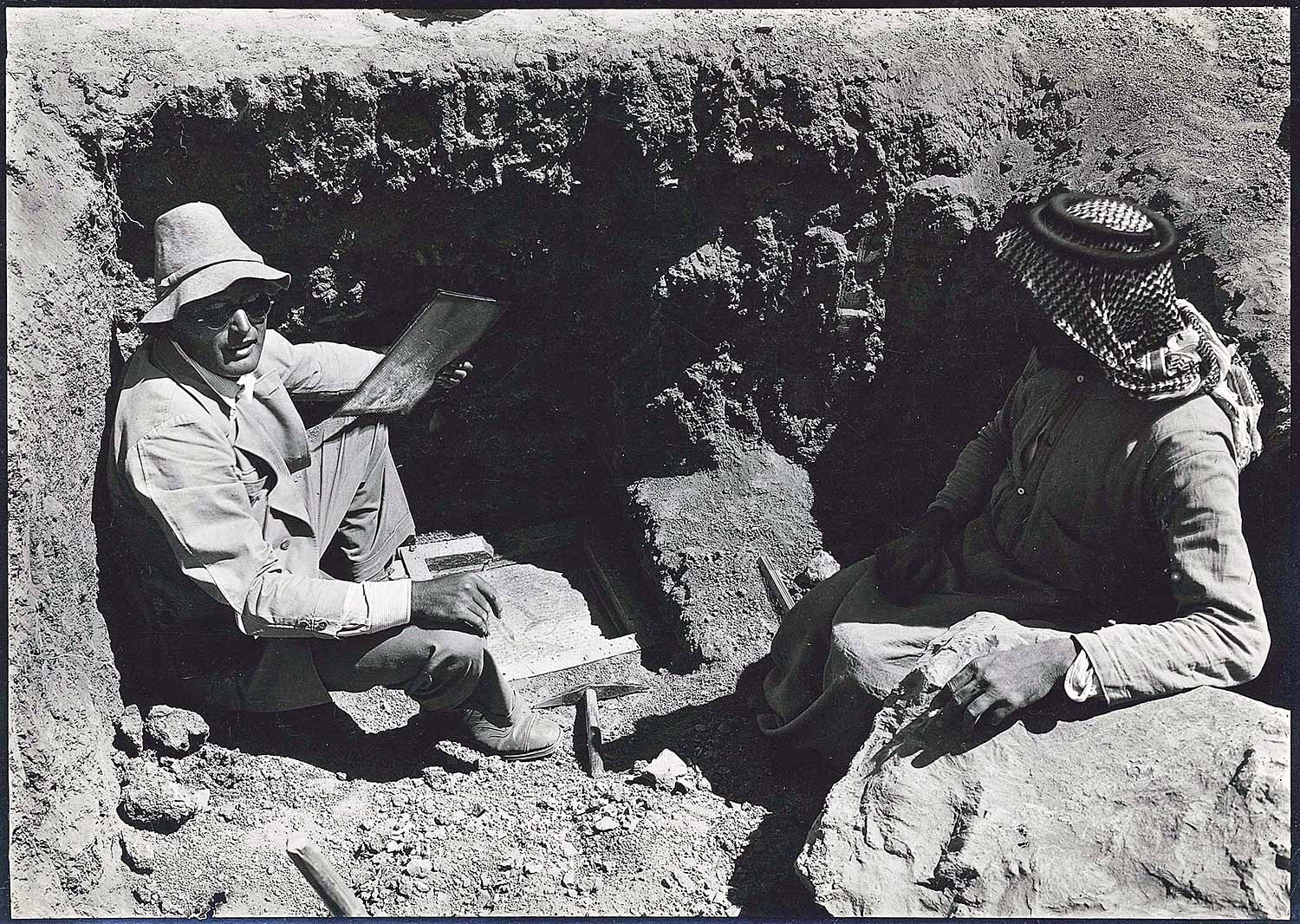 "Site architect Friedrich Krefter separates the gold and the silver tablets that were discovered at the excavation of Persepolis. Hans-Wichart von Busse, ""Excavation of tablets."" Gelatin silver print. Collection of Azita Bina and Elmar W. Seibel, TL41708.51."