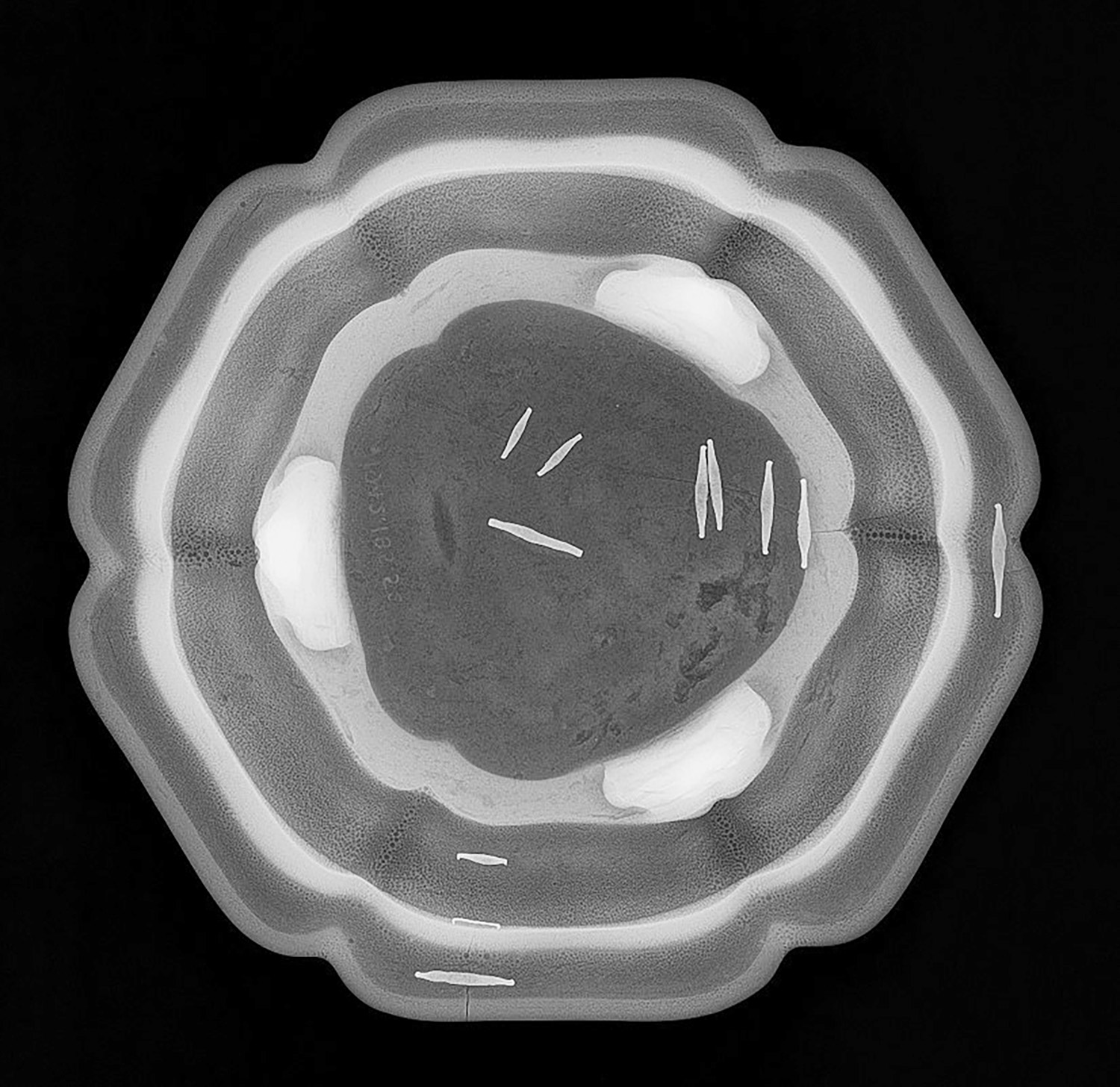 Hand-forged iron restoration staples are visible in this X-radiograph of a numbered Jun ware.