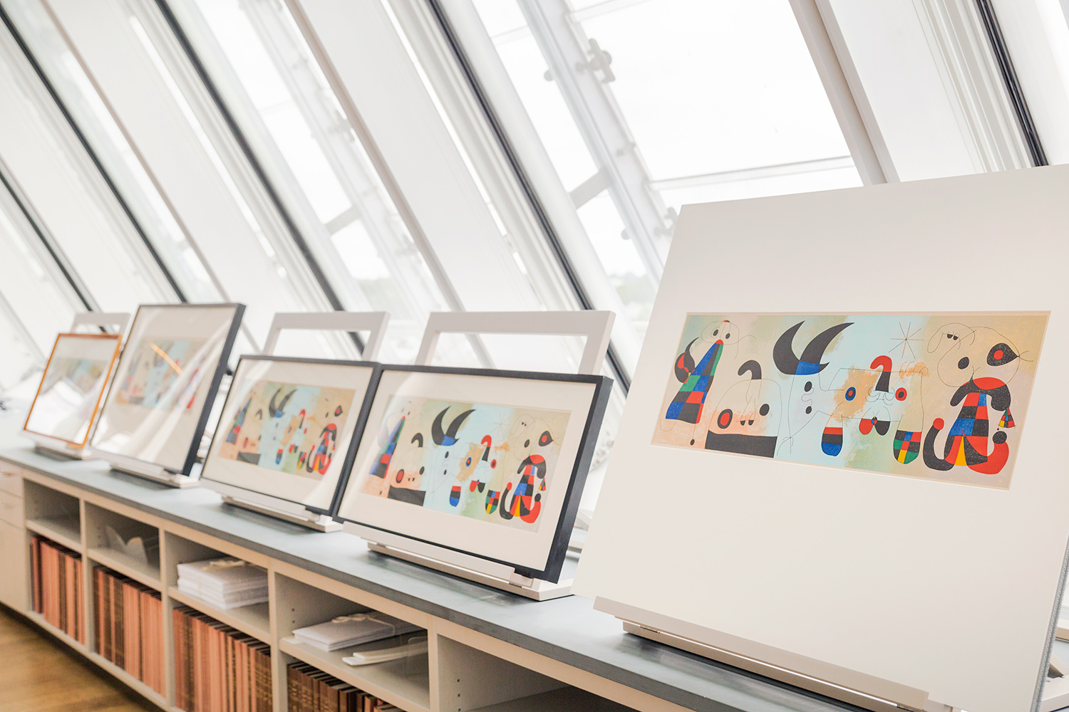 "Multiple editions of this lithograph by Joan Miró are displayed in the Art Study Center. Joan Miró, ""Composition (after Harkness Common Mural),"" 1951. Lithograph. Harvard Art Museums/Fogg Museum, Student Print Rental Program. © Successió Miró/Artists Rights Society (ARS), New York/ADAGP, Paris."