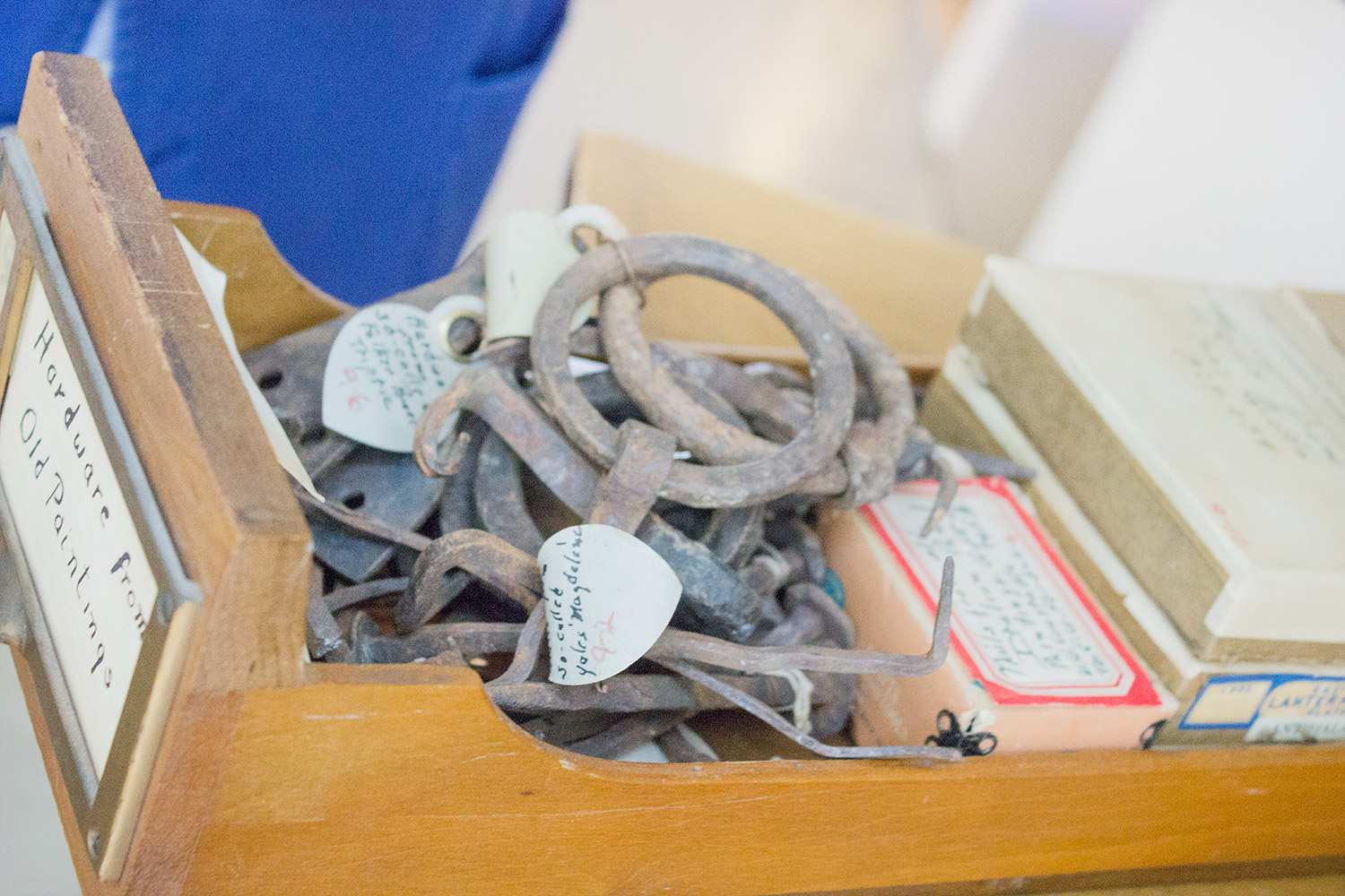 These hand-wrought metal nails and rings were once used to hang panel paintings. Each is labeled with the name of the work to which it originally belonged.