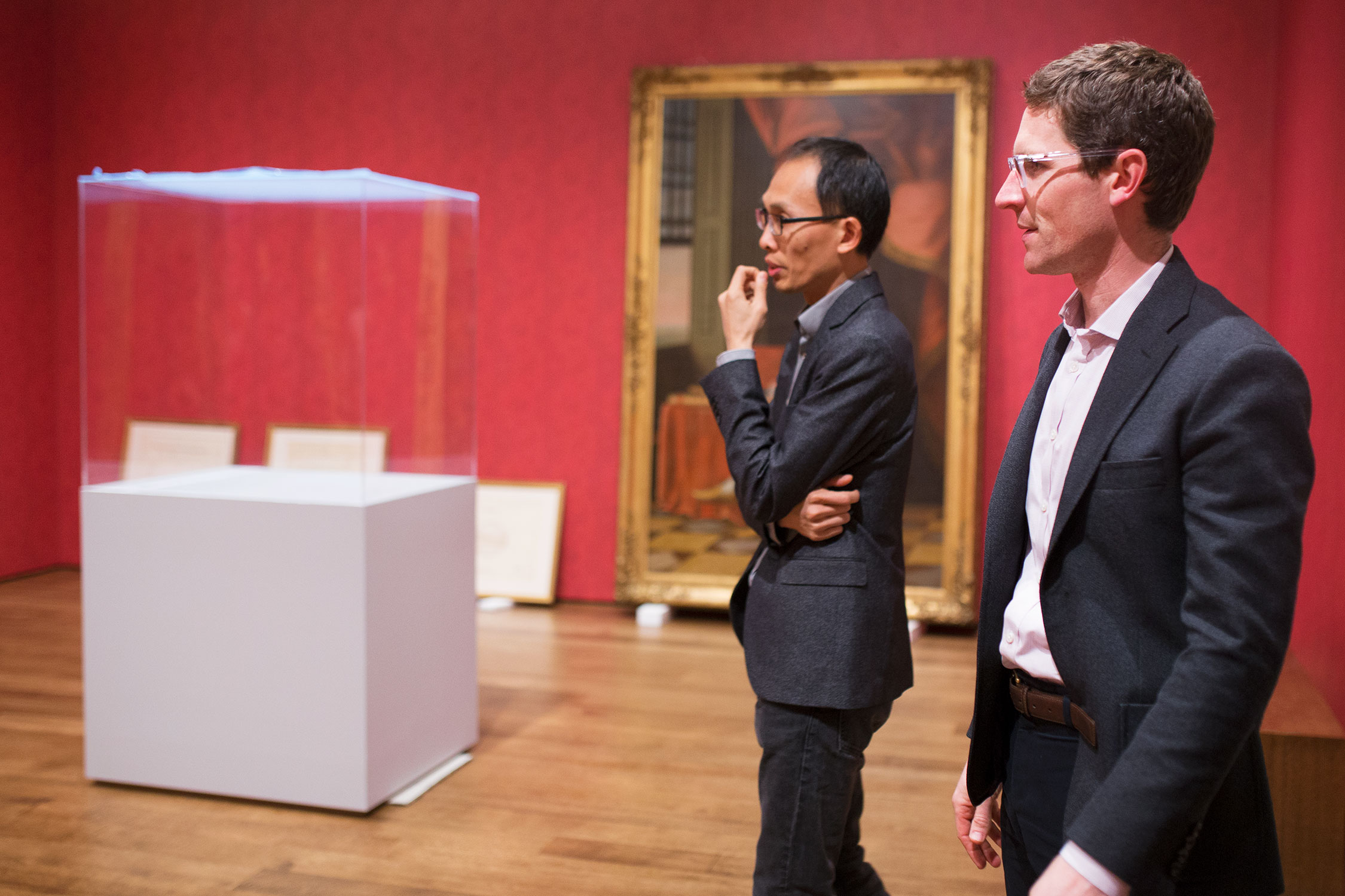 Exhibition designer Justin Lee, left, discusses the placement of objects with Ethan Lasser, curator of the exhibition.