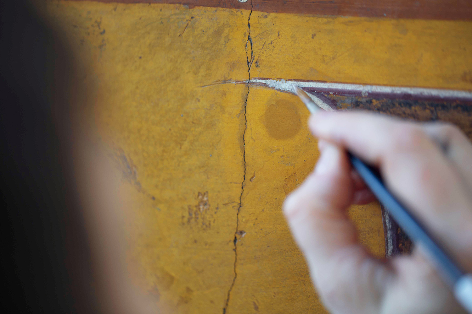 In-painting requires steady concentration and a careful hand.