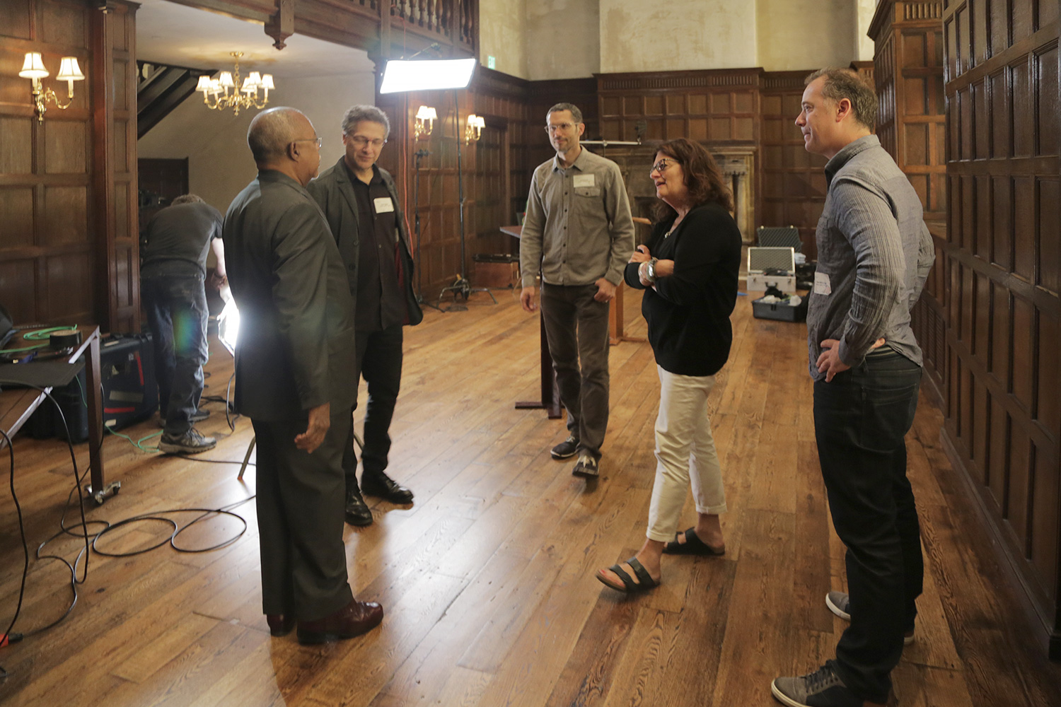 Members of the production team consult during filming in the Naumburg Room.