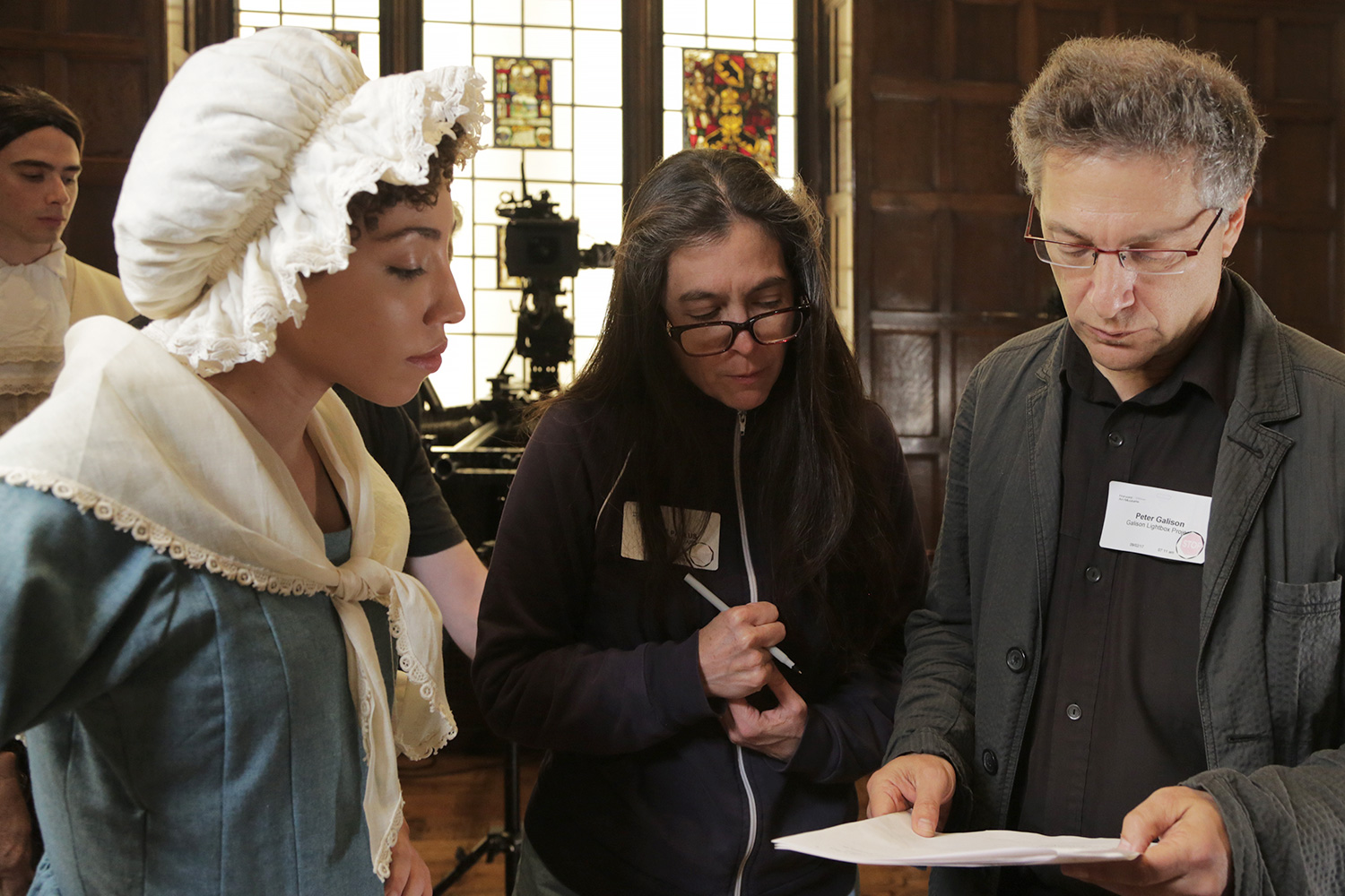 Ashley LaLonde, left, consults with Diane Paulus, center, the Terrie and Bradley Bloom Artistic Director of the American Repertory Theater, and Peter Galison, the Joseph Pellegrino University Professor and faculty director of the Collection of Historical Scientific Instruments at Harvard University, during filming of No More, America.