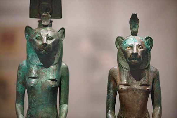 The microclimate for these two ancient Egyptian leaded bronze sculptures (Lion-Headed Deity with Atef Crown and Lion-Headed Deity with Cobra Headdress) helps maintain a low relative humidity in the air surrounding the objects.