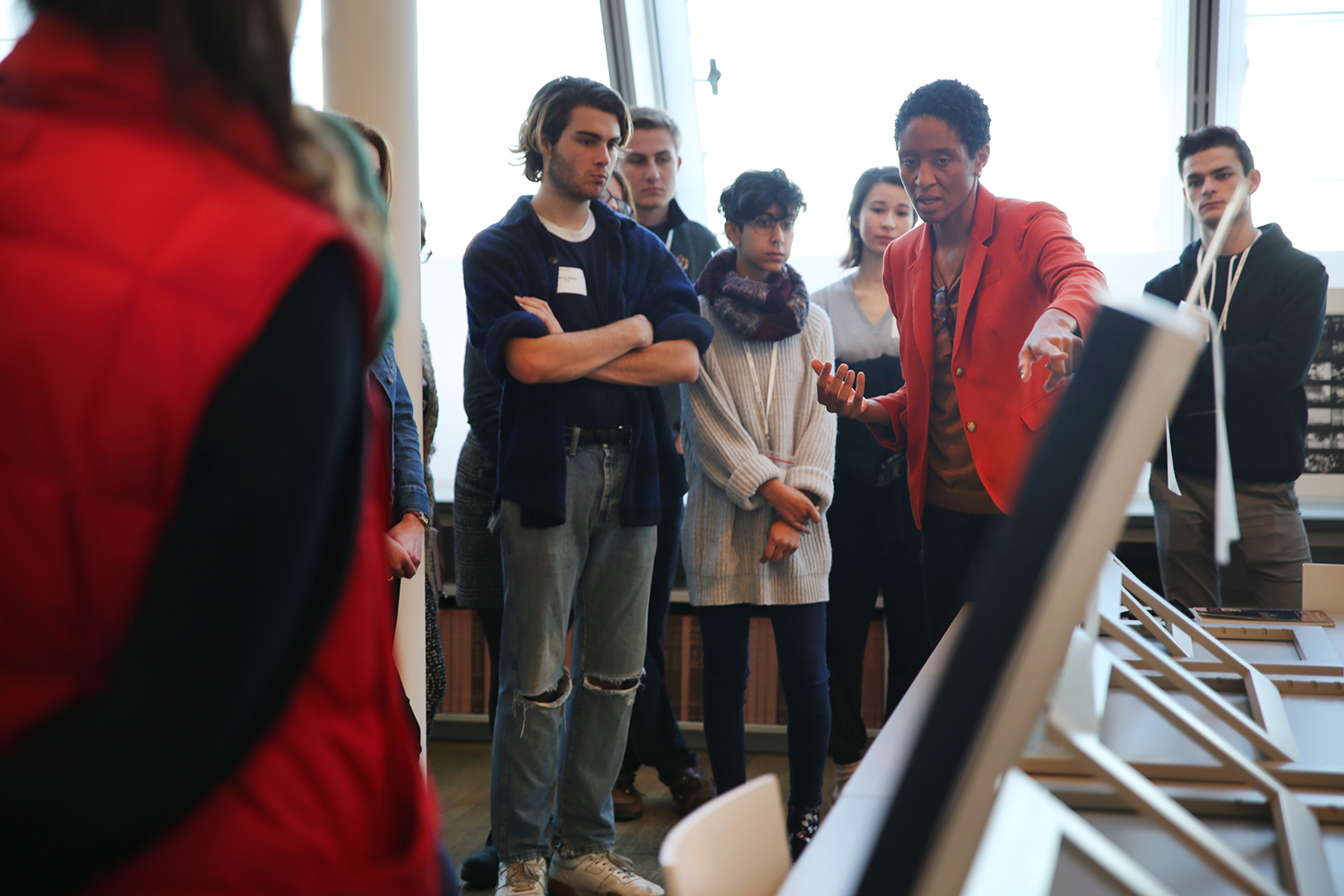 Makeda Best, the Richard L. Menschel Curator of Photography, discusses works of photography with student guides during a workshop in the Art Study Center.