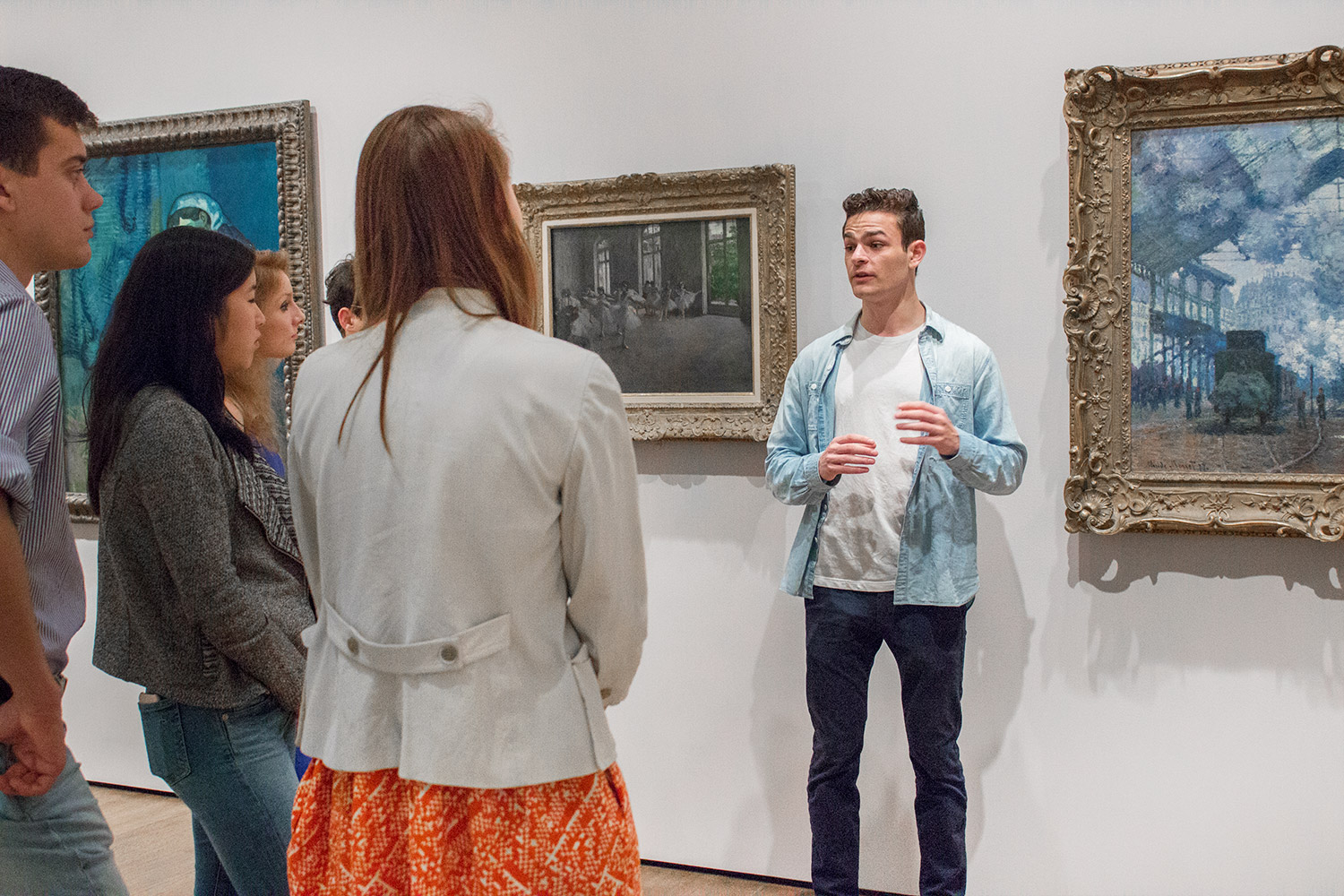 In his tour, student guide Jack Dent discusses Claude Monet's The Gare Saint-Lazare: Arrival of a Train (1877) and the artist's shift from painting rural landscapes to industrial scenes.