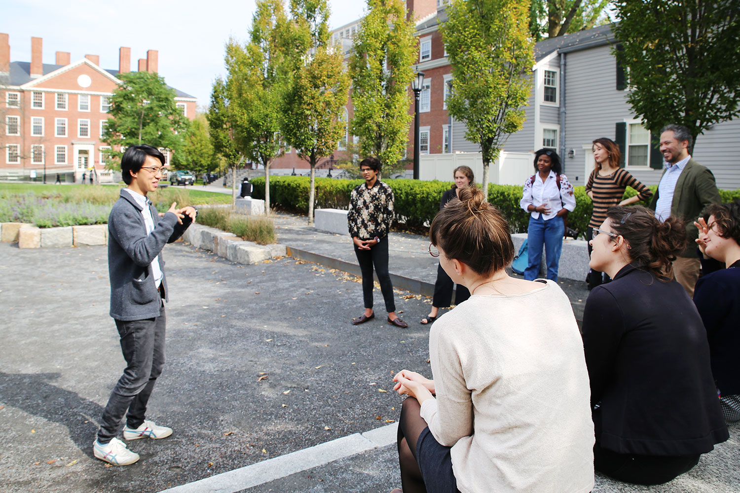 John Wang, a 2016 Harvard College graduate and former student guide, discusses his installation  100+ Years at 73 Brattle with current student guides.