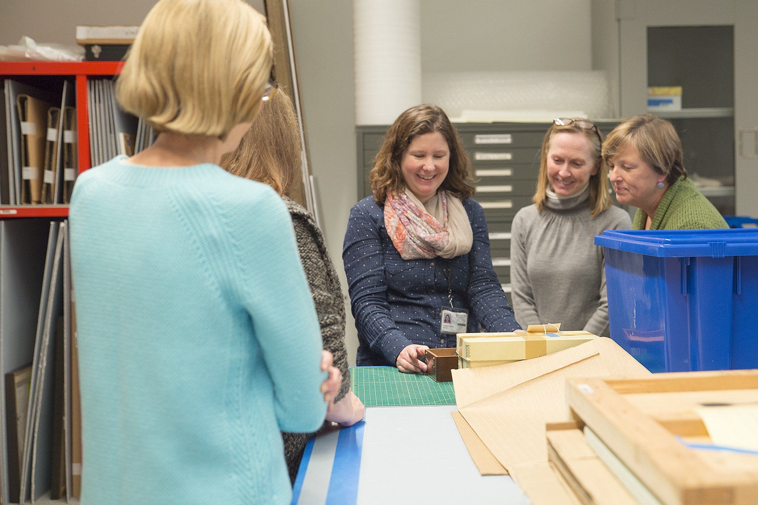 Kathryn Press, senior associate registrar for collections, center, shows an object to a group of students interested in studying new acquisitions.