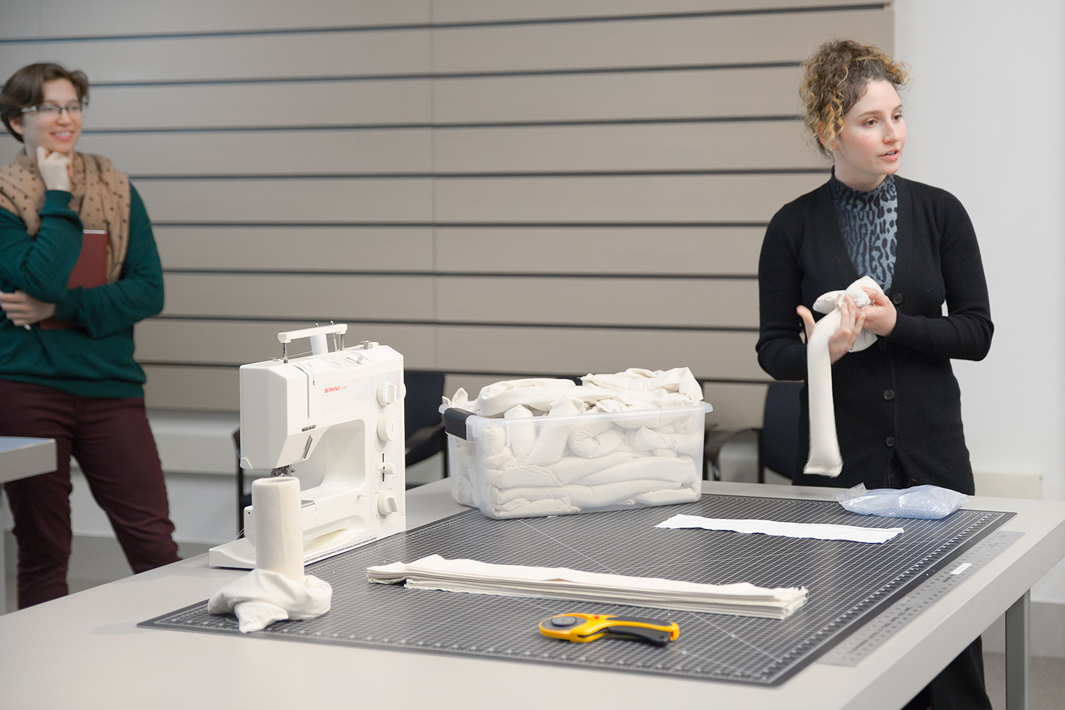During a final presentation to classmates, Stone shares highlights from her experience creating custom supports.