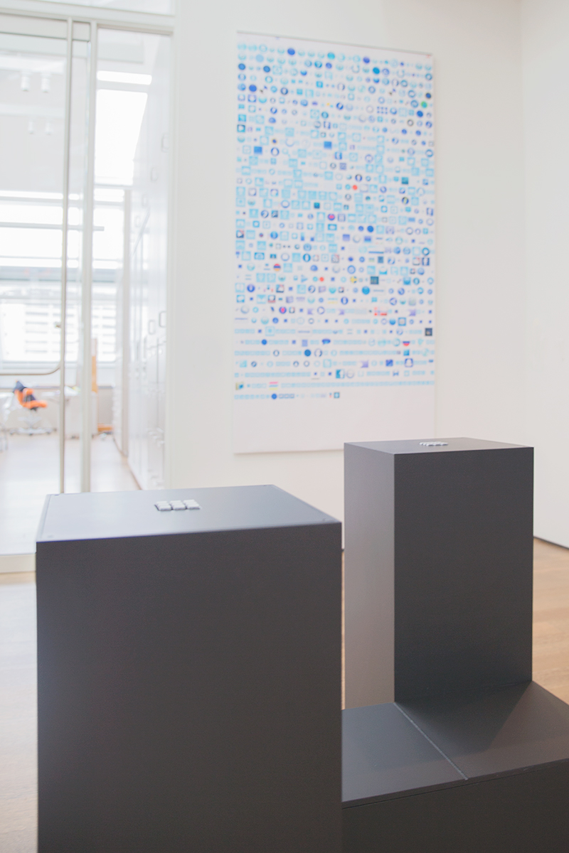 Pedestals containing a panel of buttons corresponding to a tic-tac-toe grid invite visitor participation in four of the on-screen games.