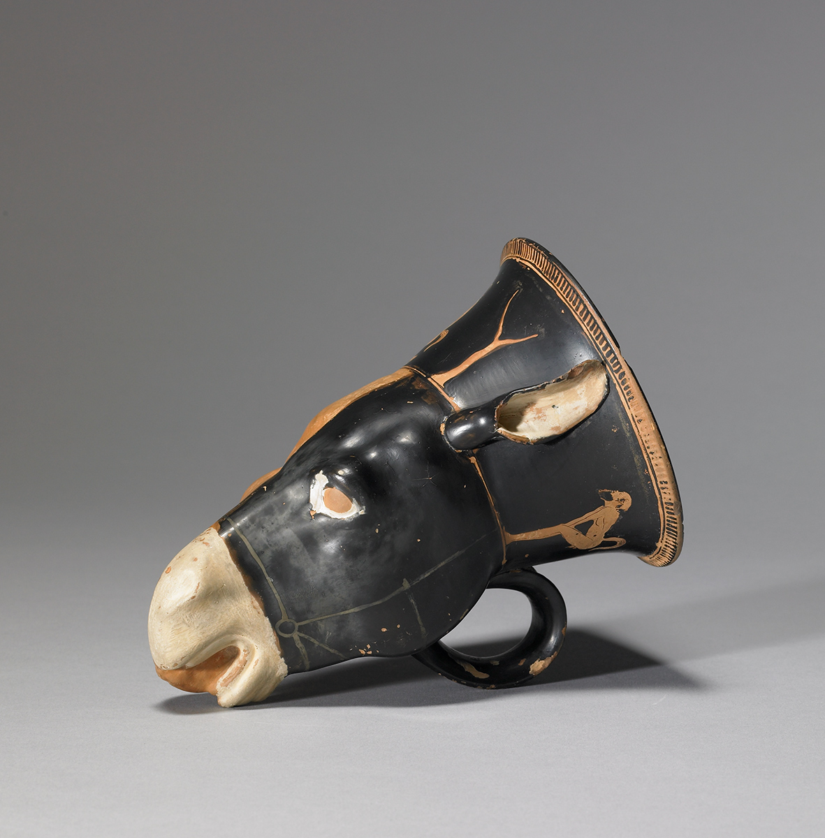 Donkey and ram head mug depicting satyrs, attributed to the Sotades Painter, Greek, Attic, c. 450 BCE. Terracotta, red-figure technique. Walters Art Museum, Baltimore, Museum purchase with funds provided by the S. & A.P Fund, 48.2050.