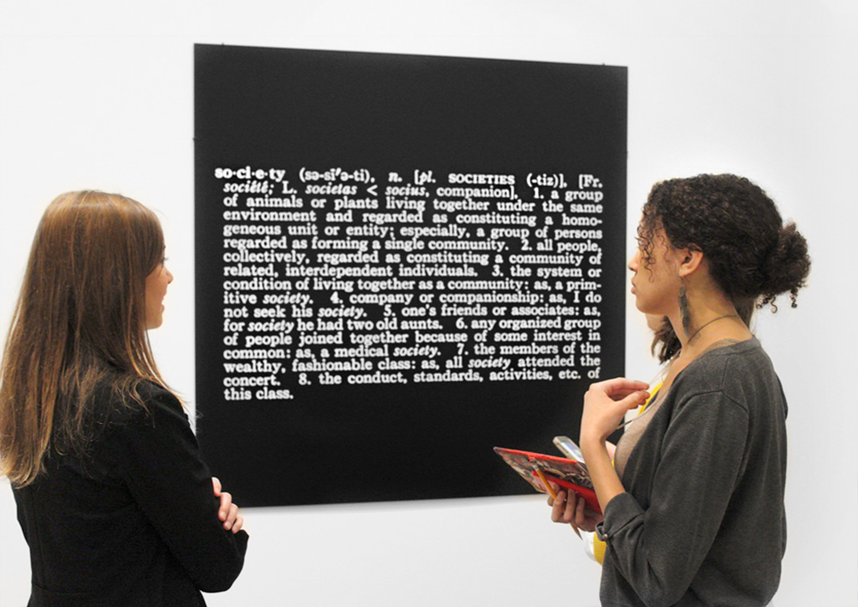 High school students from the Cambridge Rindge and Latin School discuss a print by Joseph Kosuth in the museums' modern and contemporary art galleries. As part of the Graduate Student Teacher program, select students from the Harvard Graduate School of Education spend a year collaborating with teachers to bring high school classes to the Harvard Art Museums.