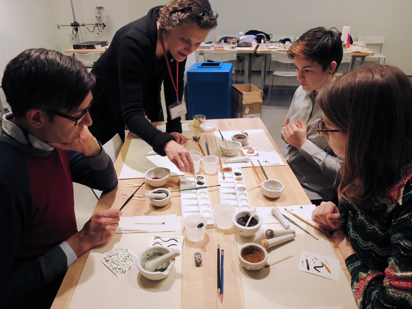 Francesca Bewer, top left, research curator for conservation and technical study programs and director of SITSA, leads an art making exercise in the Materials Lab, where many workshop sessions will take place.
