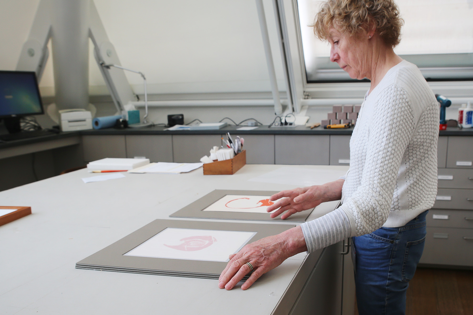 Senior conservation technician Charlotte Karney mats two of Bernard Childs's four B.B. engravings. When new works are added to the Student Print Rental Collection, they are individually matted and framed by conservators in the Straus Center for Conservation and Technical Studies.