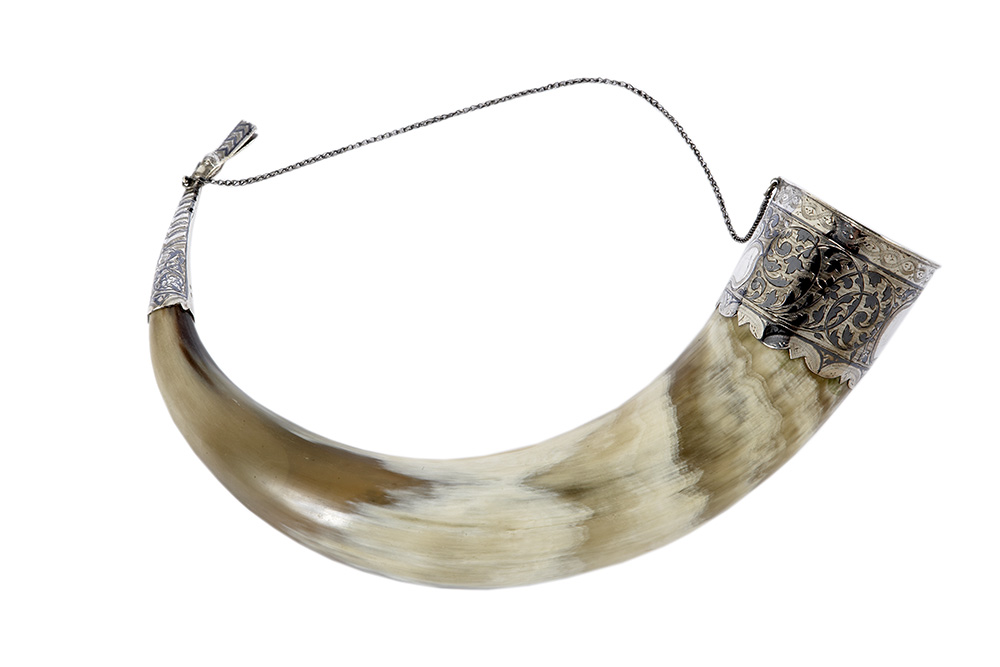 Drinking horn with duck head finial, Georgian, c. 1960 CE. Bovine horn, silver, and niello. John F. Kennedy Presidential Library and Museum, Boston, Gifts from Heads of State, MO 63.2470.1. Courtesy of the John F. Kennedy Presidential Library and Museum, Boston. Photo: Joel Benjamin.