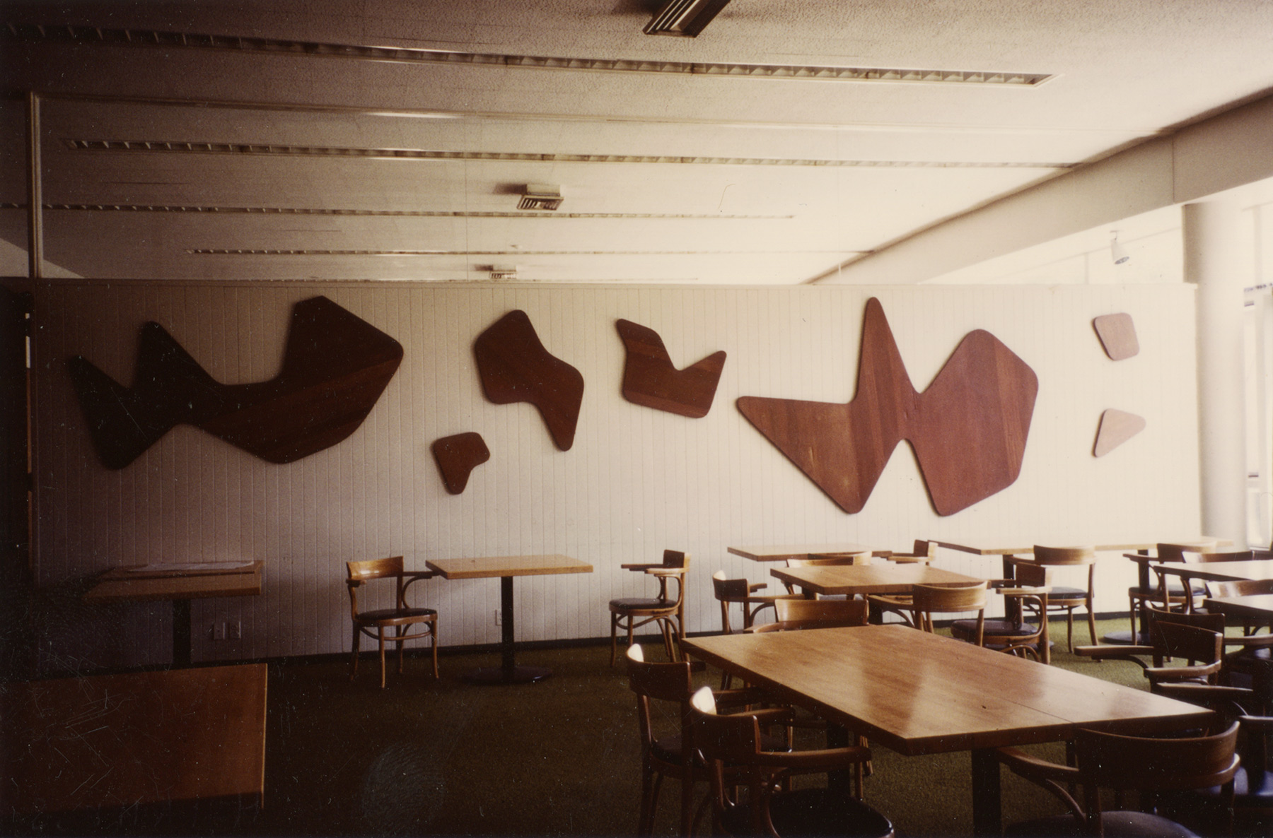 "North wall of Constellations II, 1985. Harvard Law School Buildings Collection, Special Collections, Harvard Law School Library, Harvard University. Photo: Aimée Bleikasten. Note that the paint has been stripped off of the panels, leaving them with a patchy and uneven ""natural"" finish."