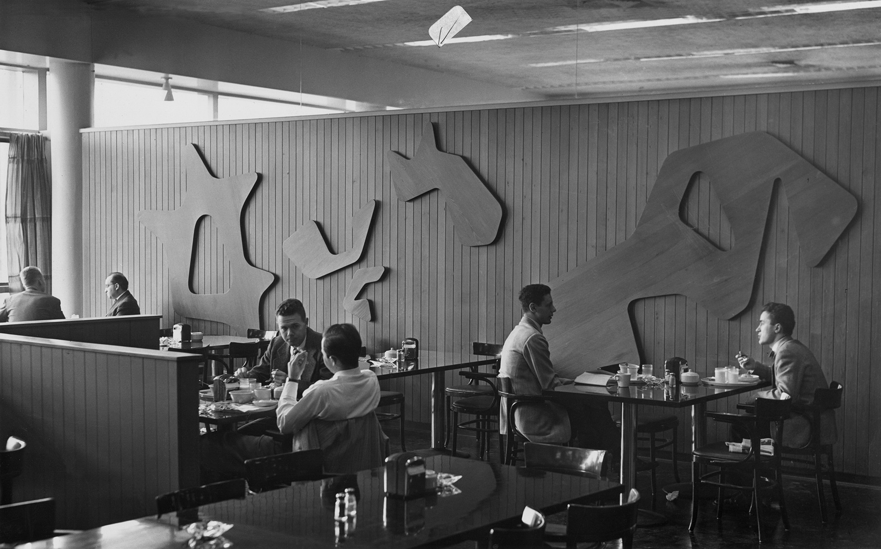 Hans Arp's Constellations as displayed in Harkness Commons Dining Room, Harvard University, c. 1950. Stiftung Arp e.V., Berlin/Rolandswerth. Photo: D. H. Wright.