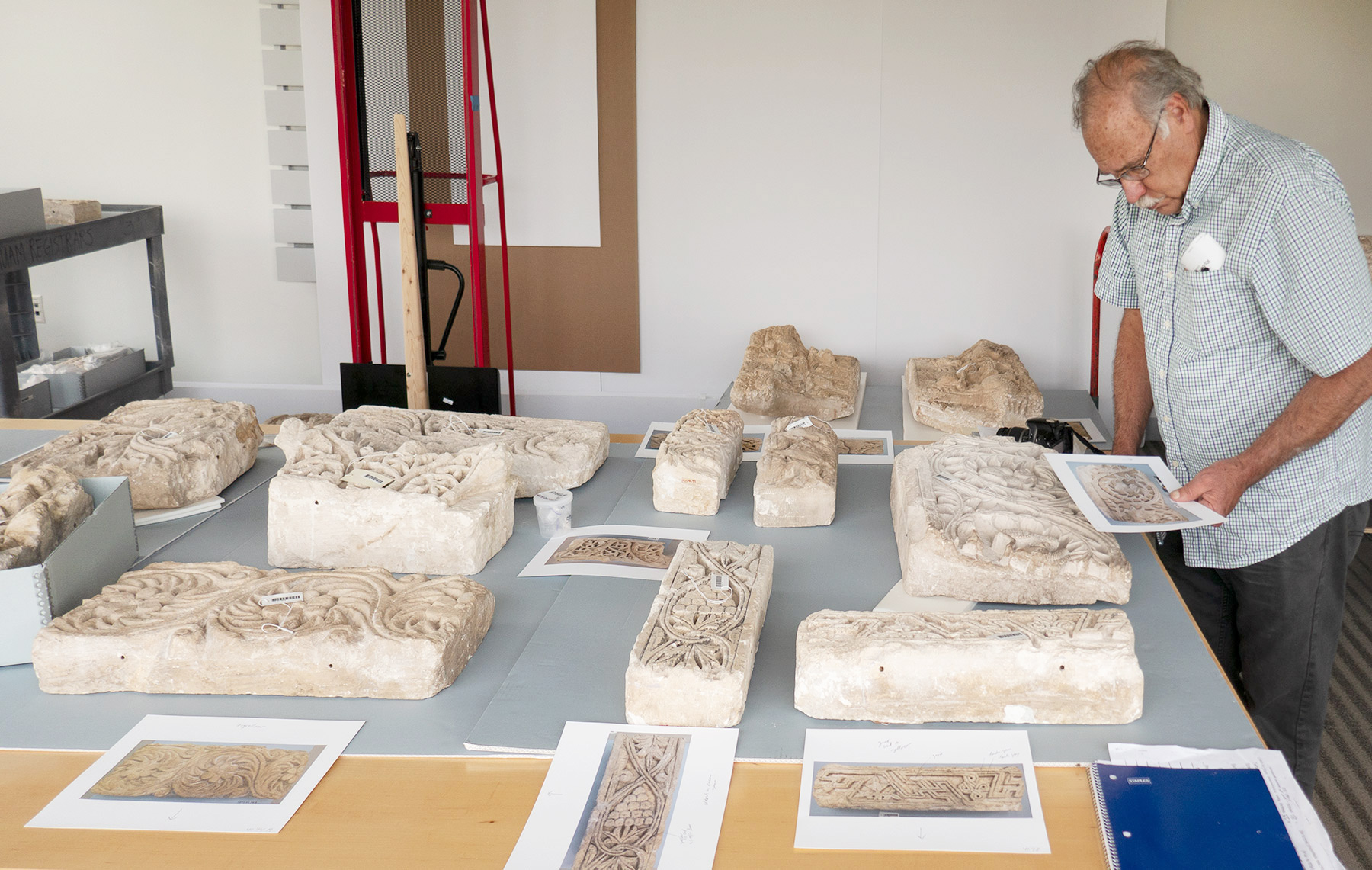 Robert Shure, of Skylight Studios, examines a selection of the original fragments.