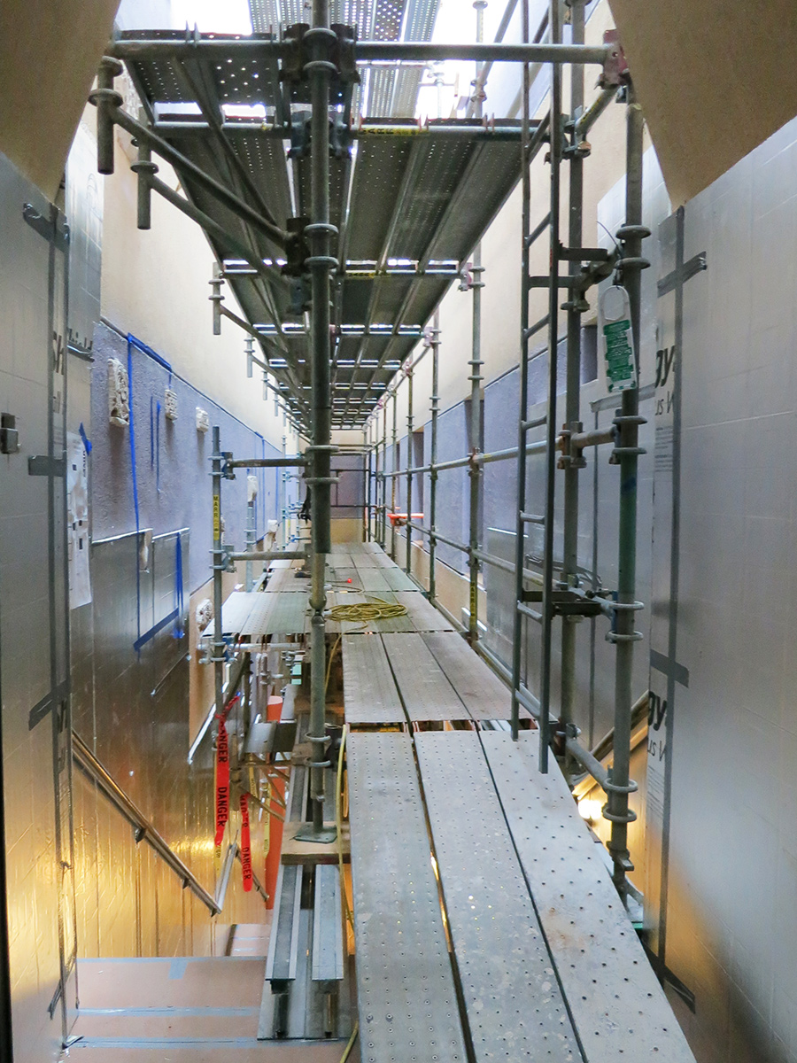 To accommodate the range of subcontractors who would need access to the walls surrounding the main staircase, a custom scaffolding and rigging system was designed.