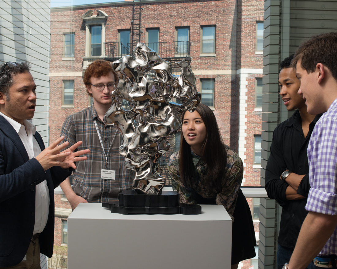 Odo, left, and four Ho Family Student Guides stand around a sculpture in the Harvard Art Museums.