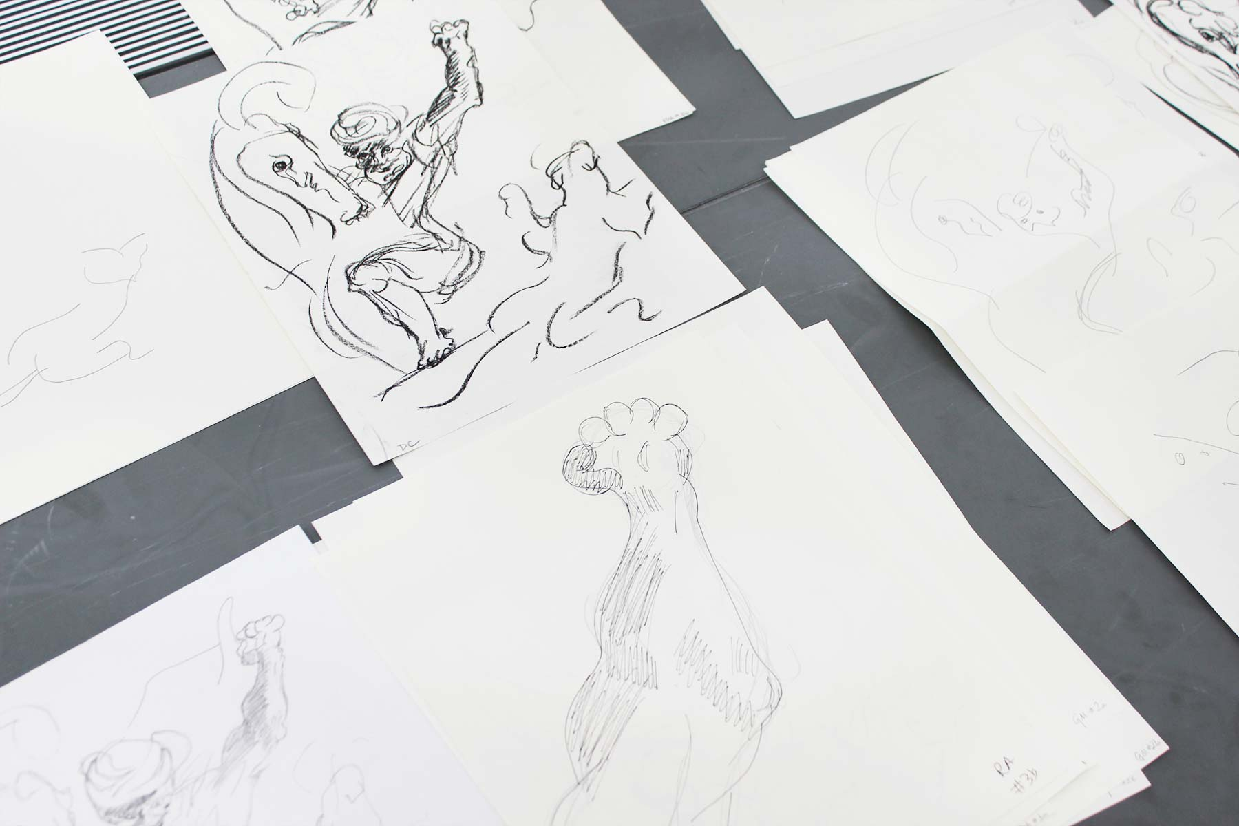 A group of overlaid drawings attempting to imitate the drawing of the man attacking the panther.