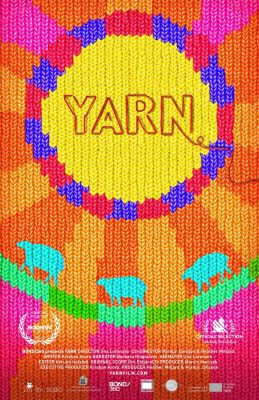 "A movie poster shows the word ""Yarn"" in the middle of a knitted design in a yellow circle, whose border is a pattern of red and blue. Rays emanate from the border in orange and pink. Toward the bottom, three blue sheep appear within the rays."