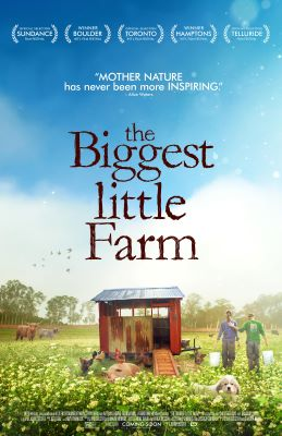 "A poster shows a farm with a red chicken coop with a tin roof. Chickens, a dog, and other animals are in the field, along with a couple, each holding a white bucket, with their backs to viewers. The words ""the Biggest little Farm"" appears above against a"