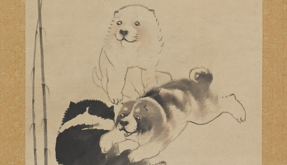 This detail from a hanging scroll shows a gray and white puppy playing with a black and white puppy beside a bamboo plant. A third puppy sits and observes them.