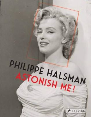 """A book cover shows a black-and-white photograph of Marilyn Monroe in profile, a red rectangular is drawn around her face. The words """"Philippe Halsman"""" and """"Astonish Me!"""" appears in diagonal over her chest."""