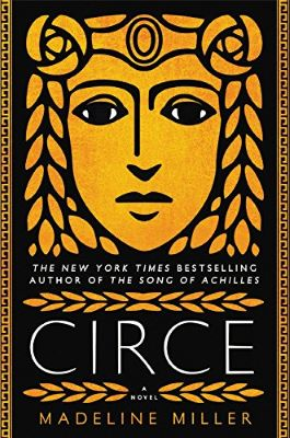"""A black book cover shows a bold, stylized gold graphic of a woman's face with a crown across her forehead. The word """"Circe"""" appears toward the bottom in large font, with the words """"A novel by Madeline Miller"""" below, and """"The New York Times Bestselling Author of The Song of Achilles"""" above."""