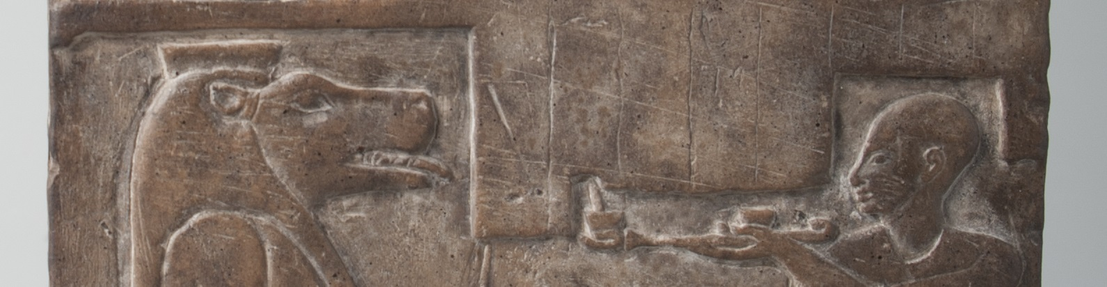 This image of the front of the stele shows a blank space incised with vertical lines.