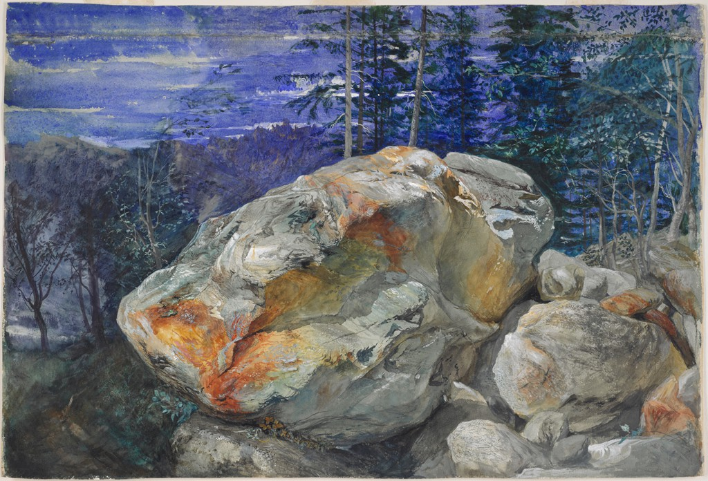 This watercolor depicts a large gray boulder with rich orange and yellow segments, centered in an outcrop of other rocks. Behind the boulder is a stand of trees, beyond which can be seen a craggy mountain peak beneath a cloudy blue sky.