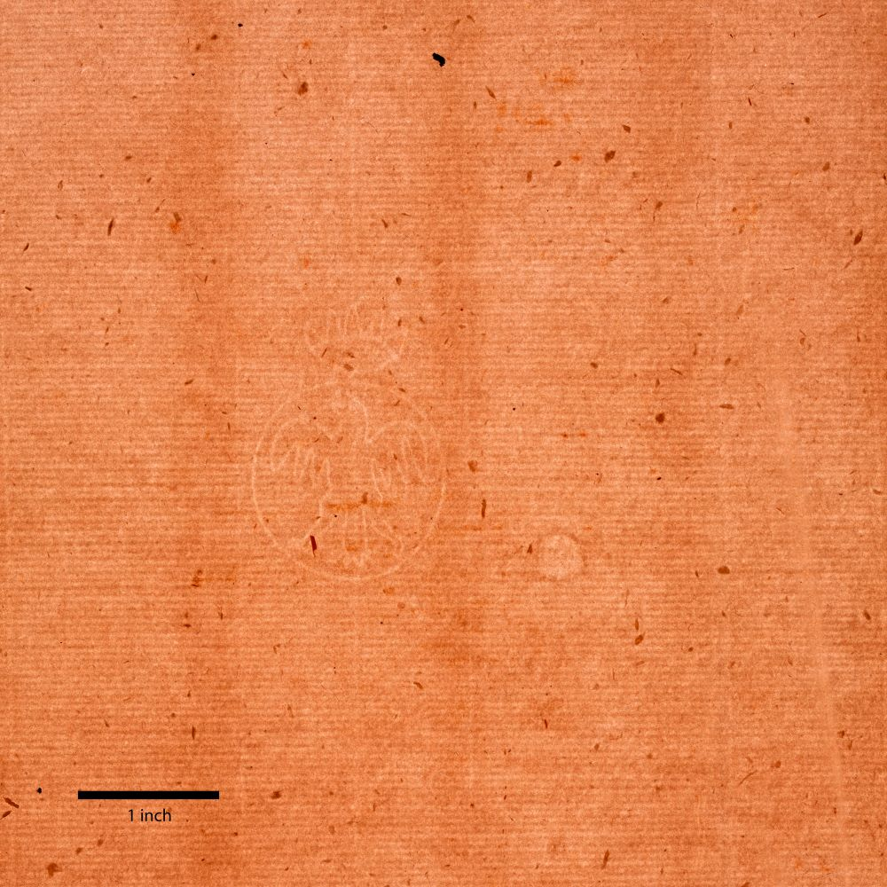 A light brown sheet of paper has a fine grid of lighter, parallel lines. Slightly off-center to the left is a watermark of a standing eagle with flapping wings, circumscribed by a circle that holds up a crown. A thick black line marks one inch at bottom left.