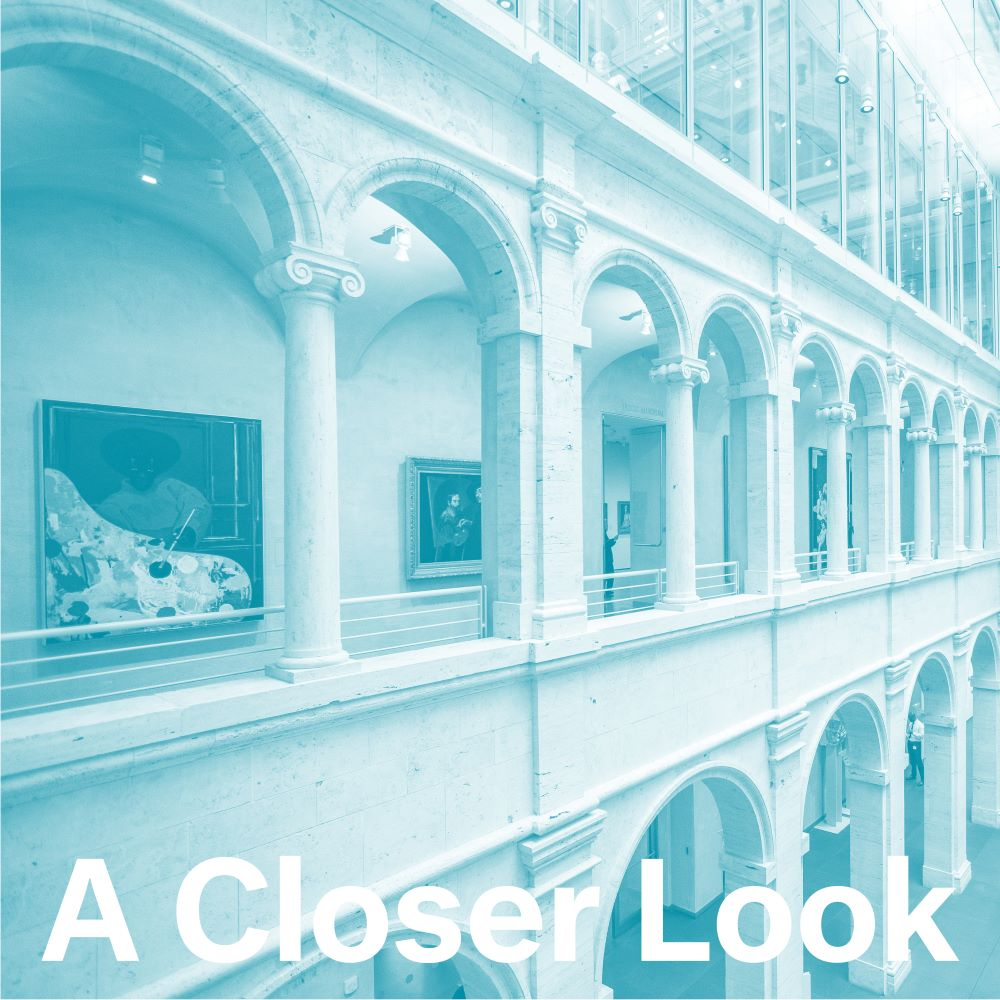 """This photograph of the interior of the Harvard Art Museums is tinted a bluish-green hue. It shows two levels of arcades with several arches. Various works of art are visible on the wall on the second level. At bottom are the words """"A Closer Look."""""""