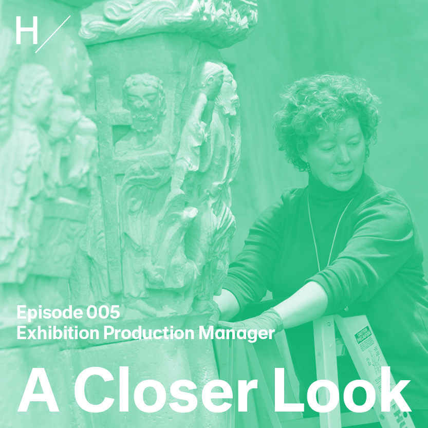 """Karen Gausch is standing near the top of a folding ladder with an ancient carved stone sculpture in front of her and to the left. She has short curly hair and wears a dark long-sleeved turtleneck, with her sleeves pushed up to her elbows. Her gloved hands are touching the base of the sculpture, and she's looking down, in the act of speaking with another person not in the picture. There's a green overlay on the image with white text that reads """"Episode 005,"""" """"Exhibition Production Manager,"""" and """"A Closer Look."""""""