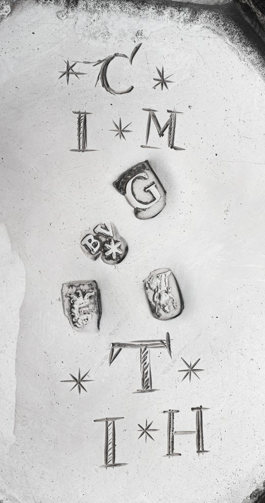 "Incised into a silver surface are two sets of initials ""C I M"" and ""T I H,"" each accompanied by star symbols. Four stamps are also on the surface: two stamps showing what appear to be creatures, a stamp with ""BV "" and a star symbol, and one letter ""G."""