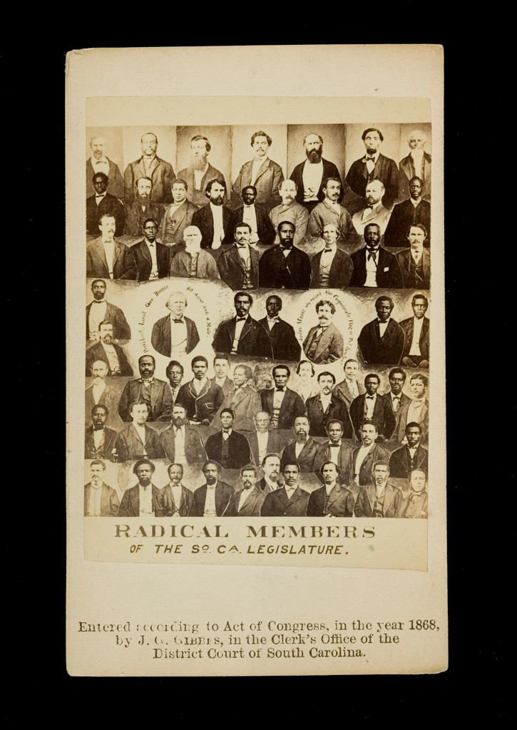 "A black and white photograph shows the bust portraits of 64 men, arranged in seven rows. The men are dressed in shirts and jackets; many appear to be wearing vests. Their ages range from young to old and their skin colors from black to white. Some are bearded, many have a mustache, and a few are clean-shaven. The busts of two men at the center of the composition are surrounded by writing. The text below reads ""Radical Members of the South Carolina Legislature."""