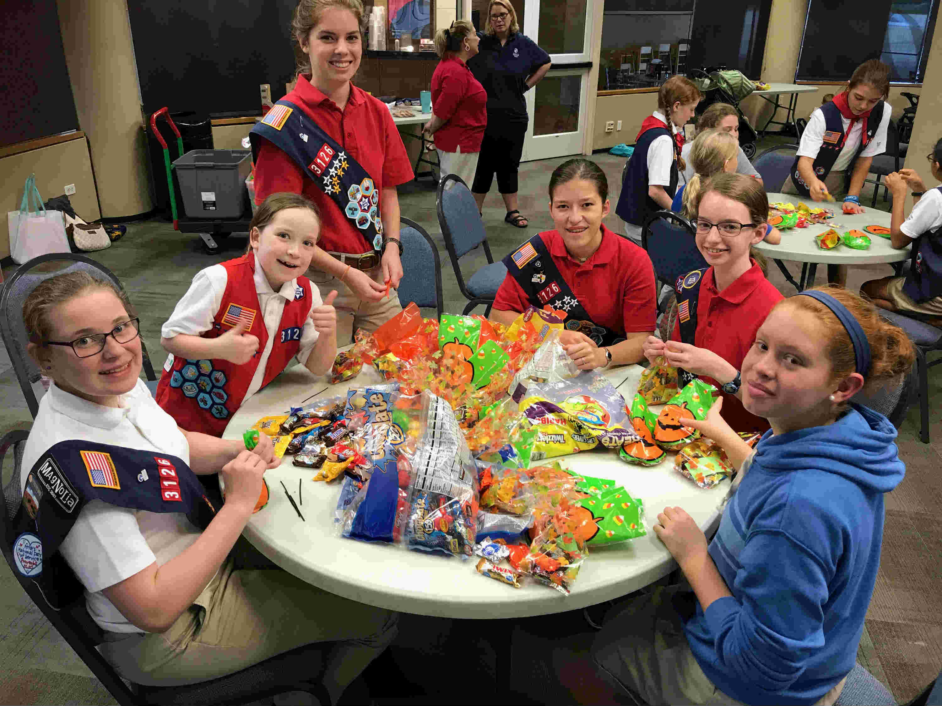 American Heritage Girls pack candy bags for Light The Night