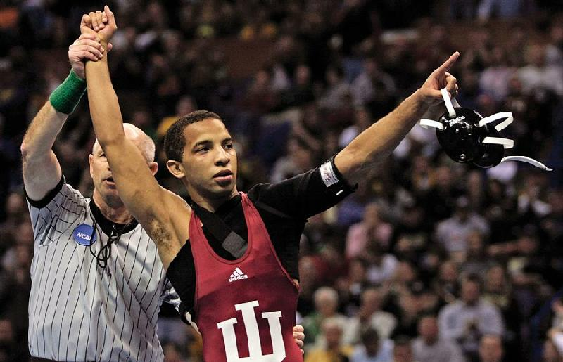 Indiana's Angel Escobedo celebrates his victory over Minnesota's Jayson Ness in a 125 pound championship match at the NCAA wrestling national championships Saturday, March 22, 2008 in St. Louis.