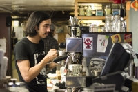 Soma win the best coffee in Blooington this year.  Steven Garicia makes a latte.