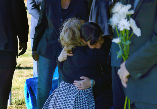 Keri Viers, wife of Associate Vice President for International Services Christopher Viers, hugs Yaolin's mother after she put flowers on her daughter's casket during the burial service on Oct. 11.