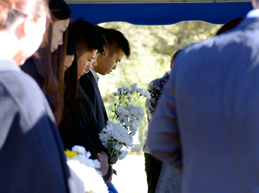 Students listen to the pastor's eulogy before Yaolin Wang's burial service on Oct.11.