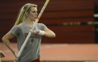 Junior polevaulter Sophie Gutermuth prepares to vault in a practice on Feb. 24, 2015 at Harry Gladstein Fieldhouse.