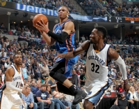 Oklahoma City Thunder guard Russell Westbrook shoots while defended by the Memphis Grizzlies' Mike Conley, left, and Jeff Green, right, at FedExForum in Memphis, Tenn., on Friday, April 3, 2015. The Grizzlies won, 100-92.