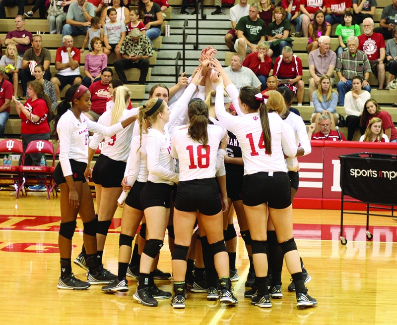 The IU volleyball team cheers before their game against Arkansas State on Sept. 16 at IU University Gym.