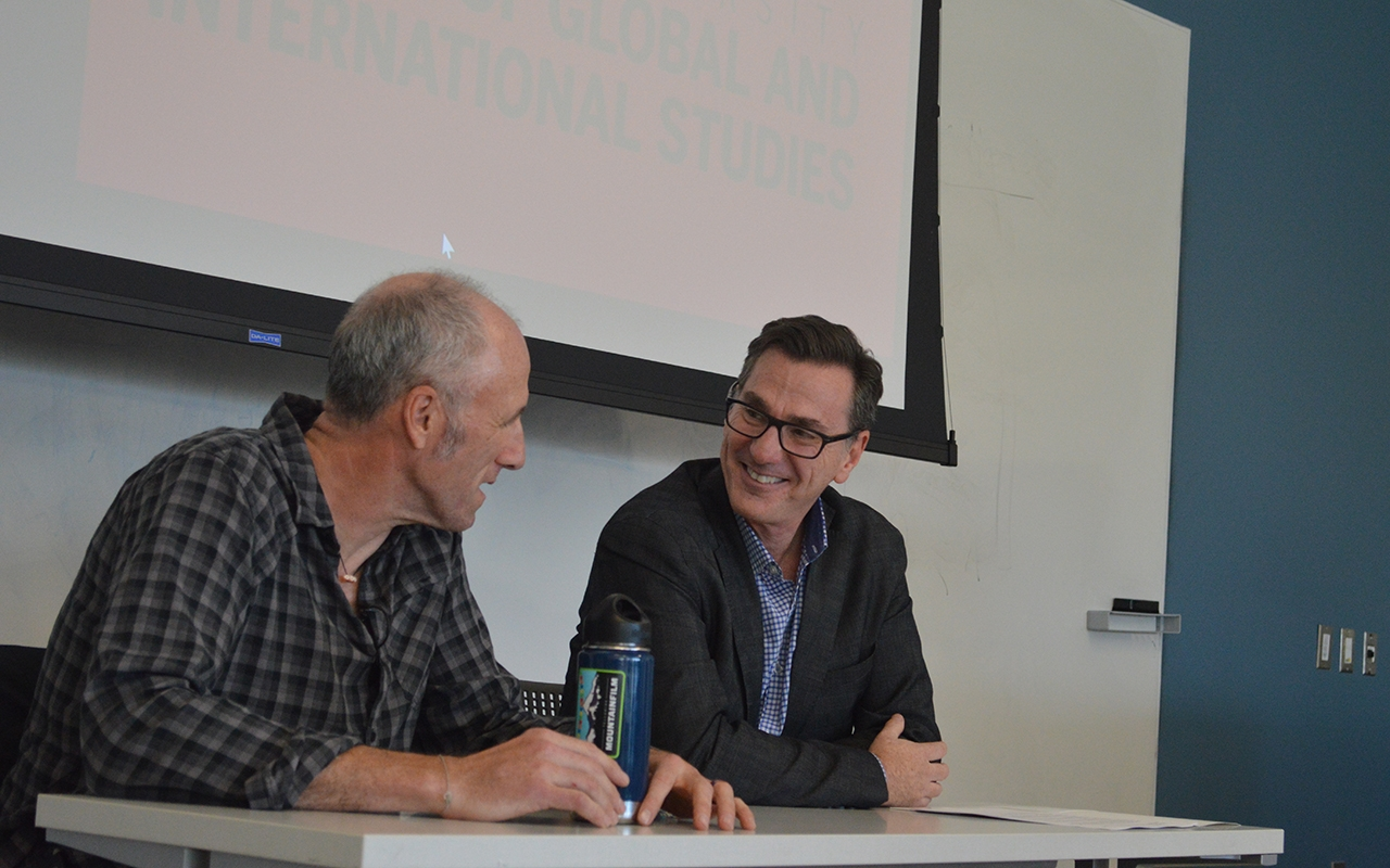 """David Holbrooke, left and Dean of the School of Global and International Studies Lee Feinstein laugh at the begining of a lecture about Holbrooke's new film """"The Diplomat,"""" Thursday afternoon. The film is about his father, Richard Holbrooke, who was an American diplomat."""